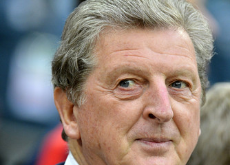 England's manager Roy Hodgson watches the warm-up before the international friendly soccer match against Ireland at Wembley stadium in London