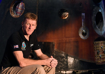 British astronaut Peake poses at a media event at the Science Museum in London, Britain