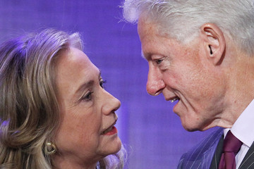 Former U.S. President Bill Clinton talks with his wife, U.S. Secretary of State Hillary Clinton, as he introduces her before her speech at the Clinton Global Initiative 2012 in New York