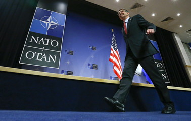U.S. Secretary of Defense Ash Carter leaves the room after a news conference during a NATO Defence Ministers meeting at the Alliance's headquarters in Brussels