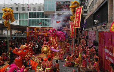 Lion and dragon dances are performed during a Chinese New Year celebration outside a shopping mall in Hong Kong