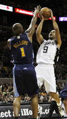 San Antonio Spurs Tony Parker shoots over Denver Nuggets Chauncey Billups during the first half of their NBA basketball game in San Antonio
