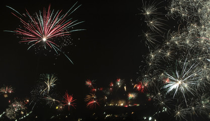 A long-time exposure shows the sky over mount Wilhelminenberg illuminated by fireworks during New Year celebrations in the west of Vienna
