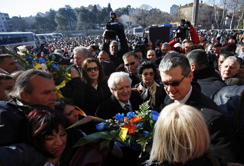 Former Bosnian Muslim warlord Abdic and wife receive flowers from citizens in front of the prison in Pula