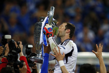 Cech of Chelsea kisses the UEFA Champions League trophy after his team's final soccer match against Bayern Munich at the Allianz Arena in Munich