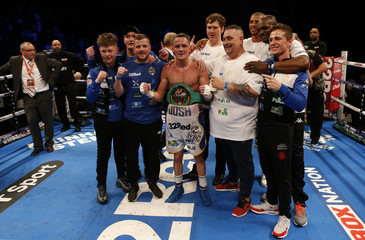 Josh Warrington celebrates after winning the fight with his team