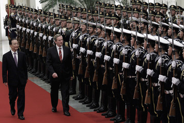 Chinese Premier Wen invites Irish PM Kenny to review the honour guard during a welcoming ceremony inside the Great Hall of the People in Beijing