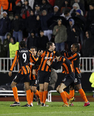 Shakhtar Donetsk's players celebrate their first goal against Partizan Belgrade during their Champions League Group H soccer match in Belgrade
