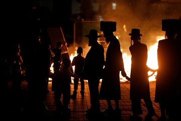 Ultra-Orthodox Jews dance around a bonfire as they celebrate the Jewish holiday of Lag Ba'Omer in the city of Ashdod