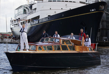 Former crewman Sutherland practises a ceremonial boat hook drill on the Royal Yacht Britannia's Royal Barge in Edinburgh, Scotland