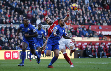 Leicester City's Danny Simpson and Wes Morgan in action with Middlesbrough's Alvaro Negredo
