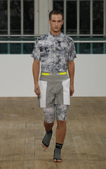 A model presents a creation from Matthew Miller for the MAN 2012 Spring/Summer collection during London Fashion Week