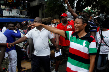 Zanetor Agyeman Rawlings, daughter of Ghana's former president Jerry Rawlings parades through a street during a presidential campaign in Accra