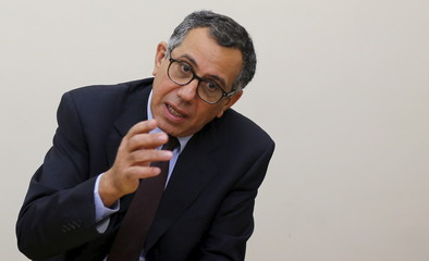 Aladdin Saba, the founder of Beltone Financial, speaks during an interview with Reuters at his office in Cairo