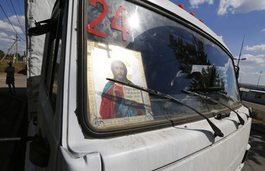 An icon is placed in the cabin of a truck of a Russian convoy carrying humanitarian aid for Ukraine near a Russia-Ukraine border crossing point in Rostov Region