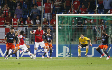 Arsenal's Gervinho shoots and scores the second goal for his team during  their Champions League soccer match against Montpellier at the Stade de la Mosson stadium in Montpellier