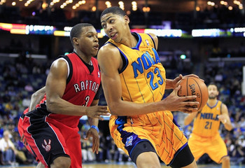 New Orleans Hornets power forward Anthony Davis is defended by Toronto Raptors point guard Kyle Lowry during overtime of their NBA basketball game in New Orleans, Louisiana