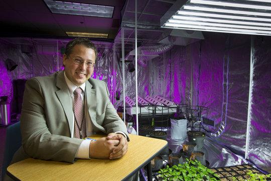 Bufford, founder of Medical Marijuana Tampa, poses inside a grow room in Tampa, Florida