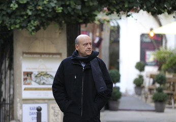 Former French Prime Minister and Mayor of Bordeaux Juppe of the UMP party leaves a restaurant in Paris