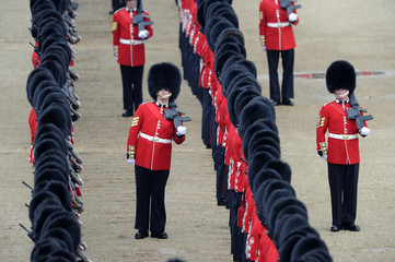 Guardsmen stand on Horse Guards Parade during the Trooping the Colour ceremony in central London