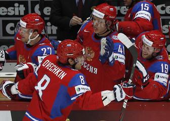 Russia's Tereshenko, Ovechkin, Kulyomin, Svitov and Kokarev celebrate scoring during their 2012 IIHF men's ice hockey World Championship semi-final game with Finland in Helsinki