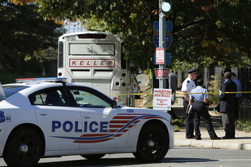 Cordoned-off police area is seen near a charter bus after an Ebola scare in Washington