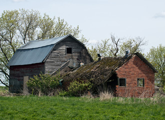 Abandoned ruined house and barn, amish neighborhood
