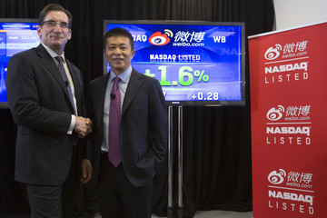 Weibo Corporation Chairman Charles Chao,  and Chief Executive Officer Gaofei Wang visit the NASDAQ MarketSite in Times Square in celebration of its initial public offering (IPO) on The NASDAQ Stock Market in New York