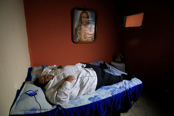 Oscar Vasquez Morales, 44, considered the most obese man in the country at about 400 kg, waits before being transferred to a clinic to get a gastric balloon implanted in Palmira near Cali, Colombia