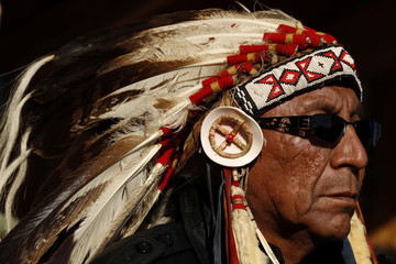 Chief Arvol Looking Horse of Green Grass South Dakota, who is the spiritual leader of the Lakota, Dakota and Nakota Sioux Nations listens to speakers inside of the Oceti Sakowin camp as demonstrations continue, in Cannon Ball