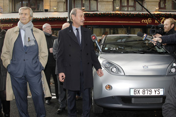 Vincent Bollore, CEO of investment group Bollore, and Paris mayor Bertrand Delanoe inaugurate the Autolib' electric car service in Paris