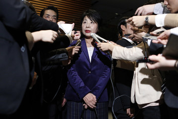 Japan's newly-appointed Justice Minister Kamikawa speaks to the media after visiting Japan's Prime Minister Shinzo Abe at his official residence in Tokyo