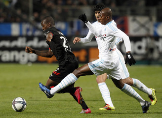 Camara of Rennes challenges  Olympique Marseille's Kabore during their French Ligue 1 soccer match at the Velodrome stadium in Marseille