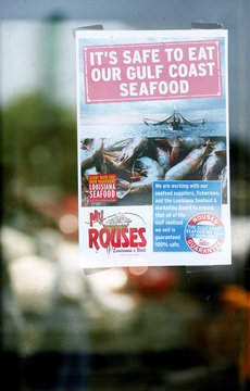 A sign is seen at a local grocery store in Metairie, Louisiana advertising safe seafood from the Gulf Coast