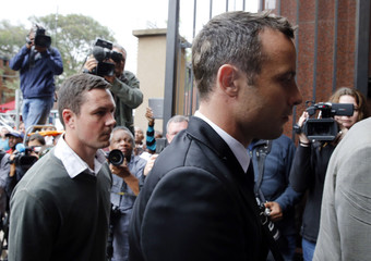 Olympic and Paralympic track star Oscar Pistorius arrives at court ahead of the fourth day of his trial for the murder of his girlfriend Reeva Steenkamp at the North Gauteng High Court in Pretoria