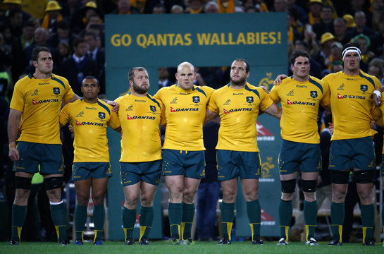 The Australia Wallabies team line up before the start of their third and final rugby union test match between their team and the British and Irish Lions at ANZ stadium in Sydney