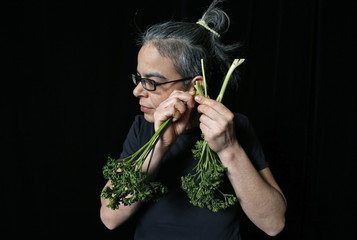 Austrian musician Tamara Wilhelm, a member of the Vegetable Orchestra, poses for a picture with a musical instrument made from vegetables in Haguenau, eastern France