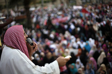 Supporter of deposed Egyptian President Mohamed Mursi gives a speech during a protest in Cairo