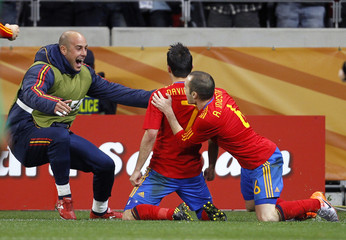 Spain's Villa celebrates with team mates Reina and Iniesta after scoring against Portugal during the 2010 World Cup second round soccer match at Green Point stadium in Cape Town