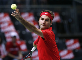 Switzerland's Federer serves a ball during his Davis Cup World Group play-off tennis match against de Bakker of the Netherlands in Geneva