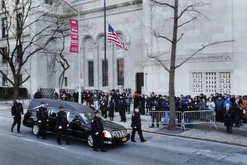 New York Police Department officers escort a hearse carrying the casket of former New York Mayor Koch into Temple Emanu-El for his funeral services in New York
