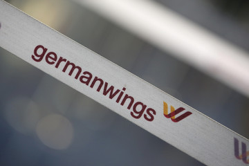 A barrier tape of German airline Lufthansa's low-cost carrier Germanwings is pictured at a closed gate of Berlin Tegel airport