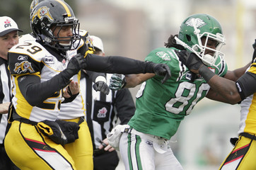 Hamilton Tiger Cats Means throws a punch at Saskatchewan Roughriders wide receiver Hill