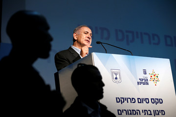 Israel's Prime Minister Benjamin Netanyahu speaks during a ceremony marking the completion of a structural reinforcement project for residences in communities close to the Gaza Strip, in the southern Israeli town of Sderot