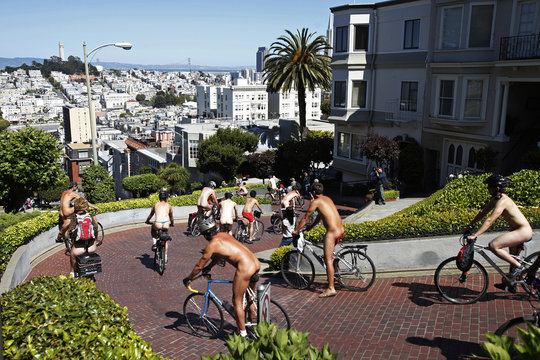 Naked cyclists negotiate the hairpin turns down Lombard Street during the World Naked Bike Ride in downtown San Francisco
