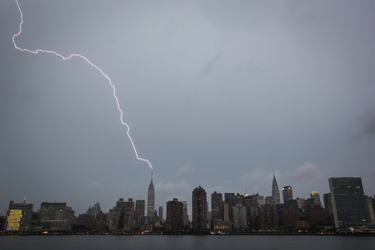 Bolt of lightning strikes the Empire State Building during a summer rain storm in New York