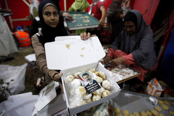 A supporter of deposed Egyptian President Mursi shows a box of sweets with a picture of Mursi on top in Cairo