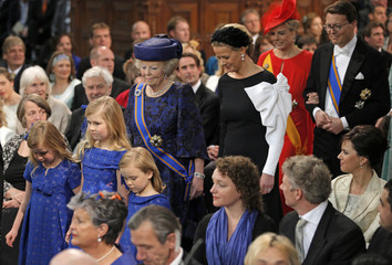 Netherlands Princess Beatrix follows the granddaughters Crown Princess Catharina-Amalia Princess Alexia and Princess Ariane on the arrival to the Nieuwe Kerk church in Amsterdam before the religious crowning ceremony