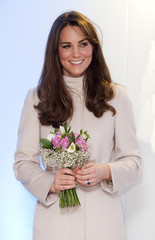 File photogrpaph shows Britain's Catherine, Duchess of Cambridge holding a bouquet of flowers after it was presented to her by Jamie Andrew during a visit to the City Hospital in Peterborough
