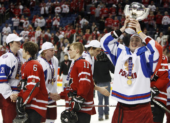 Russia's Kitsyn holds the trophy after the gold medal game at the IIHF World Junior Hockey Championships in Buffalo